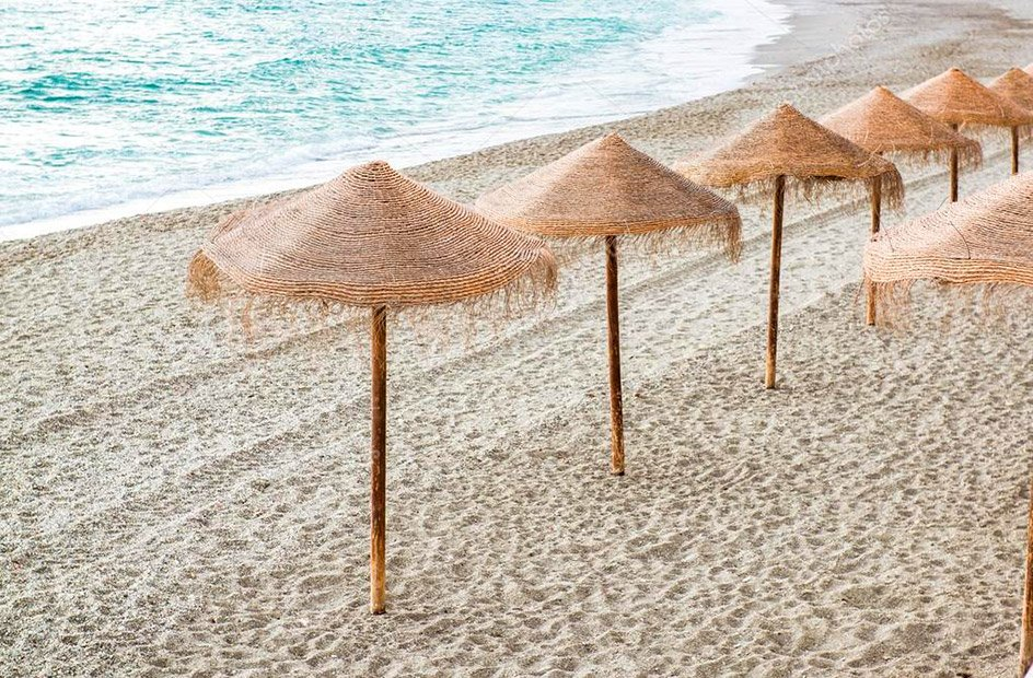 depositphotos_40706423-stock-photo-straw-parasols-on-empty-beach.jpg